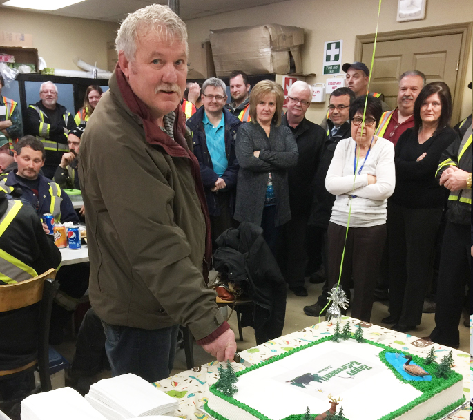 John Newman, AGD Operations Manager, cutting his retirement cake.